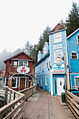 Tourist shops and homes along Creek Street in downtown Ketchikan, Southeast Alaska, USA, Spring