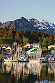 View of boats in Sitka Harbor and homes and the Sisters Mountains in the background, Sitka, Southeast Alaska, summer