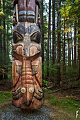 The Base of a large Totem Pole in Sitka National Historic Park, Sitka, Southeast Alaska, USA, Summer