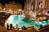 Tourists at Trevi Fountain at nighttime, Rome, Italy