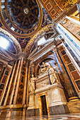 Dome ceiling and ornate facade, St. Peter's Basilica, Rome, Italy