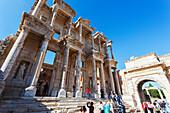 Tourists at the ruins of the Celsus Library, a monumental tomb for Gaius Julius Celsus Polemaeanus, Ephesus, Izmir, Turkey