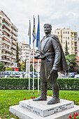 Statue with residential buildings and a parking lot, Thessaloniki, Greece