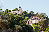 Church buildings on a hill surrounded by trees, Athens, Greece