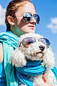 Girl and her dog wearing matching sunglasses, Balsam Lake, Ontario, Canada