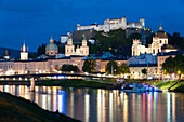 View over the Salzach to the old town and Hohensalzburg Fortress at dusk, the historic center of the city of Salzburg, a UNESCO World Heritage Site, Austria