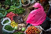 Vegetable vendor sitting on a street, Pushkar, Rajasthan, India