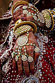 Person with decorative designs on her hands at the annual Ms Moomal competition at Jaisalmer Desert Festival, Rajasthan, India