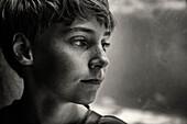 Close up of face of serious Caucasian boy