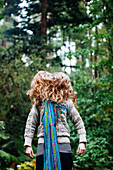Caucasian woman tossing hair in forest