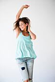 Mixed race woman dancing