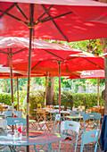 Cafe tables under parasols in rural France, Europe