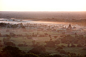 Mists from the nearby Irrawaddy River floating across Bagan Pagan, Mandalay Division, Myanmar Burma, Asia