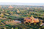 Early morning sunshine over the terracotta temples of Bagan, the Irrawaddy river in the distance, Bagan Pagan, Mandalay Division, Myanmar Burma, Asia