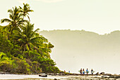 Surfers strolling on the beach at this hip southern Nicoya Peninsula surf resort, Santa Teresa, Puntarenas, Costa Rica, Central America