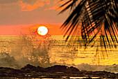 Sun going down behind surf spray at this resort near Mal Pais, southern Nicoya Peninsula, Santa Teresa, Puntarenas, Costa Rica, Central America