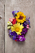 Directly above shot of various flowers on wooden table
