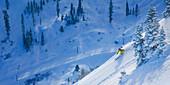 Male skier enjoying the fresh powder snow. Photo by Thomas Kranzle.
