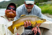 Two men with a 21 inch Brown on the Green River
