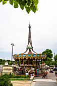 Merry-go-round in front of Eiffel Tower, Paris, France, Europe