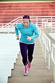 Caucasian athlete running up stairs