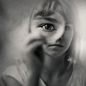Caucasian girl looking through magnifying glass