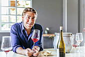 Caucasian man drinking wine in restaurant