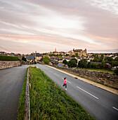 Caucasian woman jogging on road