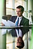 Executive reviewing paperwork