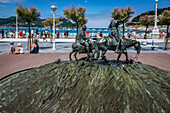 promenade on the la concha beach and sculpture of don quixote and sancho panza, san sebastian, basque country, spain