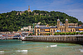 promenade on the la concha beach, mount urgull, town hall, san sebastian, donostia, basque country, spain