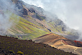clouds and colors in the haleakala crater, hiking trail on the volcanic rock, maui, hawaii, united states, usa