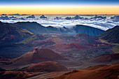 haleakala at sunrise, clouds pouring into the crater, maui, hawaii, united states, usa