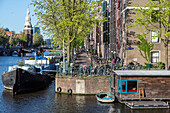 houseboat and barge, houtkopersburg and zwanenburgwal, amsterdam, holland