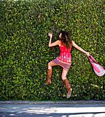 Stephanie Crocker runs into a large hedge while walking the innocent neighborhoods of Santa Cruz, California.