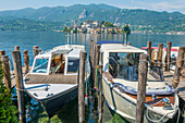Boats moored in a harbour on Lake Orta Orta, Piedmont, Italy
