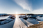 Man standing at Vatnajokul at sunset, Winter, Cold, Iceland