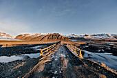 Gravel Road over a Bridge at sunset, Winter, Cold, Gletscher Vatnajokull, Vatnajokul, Iceland