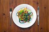 Directly above shot of colorful noodles served on plate