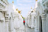 Kuthodaw pagoda - stupas housing the world's largest book, consisting of 729 large marble tablets with the Tipitaka Pali canon, Mandalay, Myanmar Burma, Southeast Asia