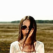 Caucasian woman standing in rural field