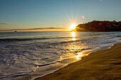 Sunset over horizon at remote beach