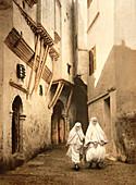 Two Women Walking Along Red Sea Street, Algiers, Algeria, Photochrome Print, circa 1901