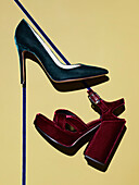 Directly above shot of high heels on beige background