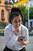 Portrait of cheerful waitress at Bellini Italian restaurant Marktplatz market square in Altstadt old town