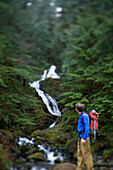 Adam Welch explores the area around Bunch Falls in the Quinault section of Olympic National Park, Washington