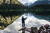 A young woman in her early thirties Fly Fishing on Emerald Lake, Weminuche Wilderness, Southwest Colorado.