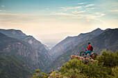 Brandon Peterson stops for a mid ride overlook in American Fork Canyon, Utah