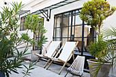 Deckchairs on hotel patio