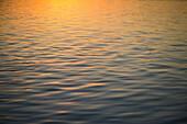 Sunset reflected on surface of water